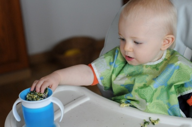 Stacking food in his cup.