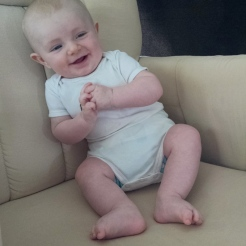 Having fun sitting up in a chair.