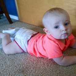 Crawling around with his diaper cover around one leg. 0_o