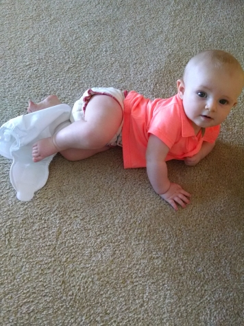 Oh just crawling around with his diaper cover around his leg