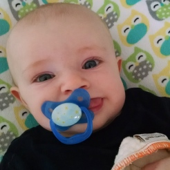 Being silly with his pacifier.