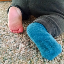 Somebody has learned how to take off his socks.