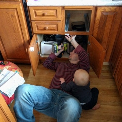 """Helping"" daddy baby proof the kitchen."