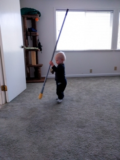 Carrying the broom around