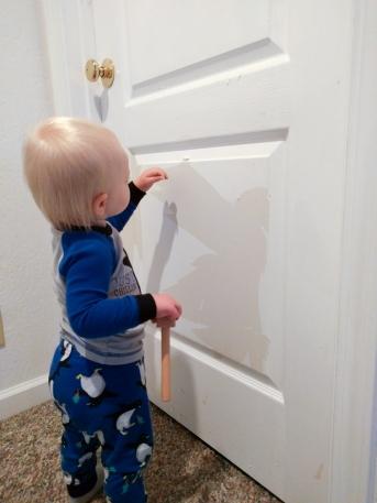 Shoddy work = Gabe peeling paint off the door